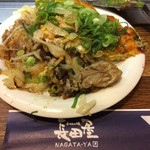 Okonomiyakinagataya - 広島産カキ入りお好み焼きの一部です