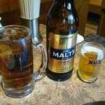 86175933 - お決まりの瓶ビールとウーロンハイ