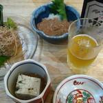 東京イカセンター - なめろうと塩辛とお通しと瓶ビール。