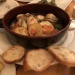 デザート - 牡蠣と男爵のアヒージョ