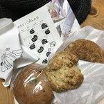 ふじっこぱん - 料理写真:カヌレのイラスト付き袋とベーグル、スコーン、ドーナツ