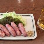 87193257 - 黒豚ソーセージと生ビール
