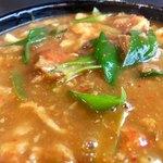 87390438 - 唐辛子の辛味を感じる カレースープ