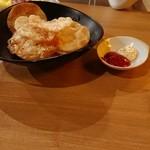 87438387 - お通し  餃子の皮を揚げたもの。  マヨとケチャで