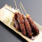 博多黒鉄 今泉 - 豚肉を串に巻きつけて揚げ、お肉の旨みを閉じ込めました。こちらもリピーターの多い一品です♪