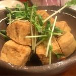 87784790 - カラッと揚げた島豆腐のニンニク醤油かけ