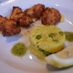 87835278 - Tempura of Monkfish with a Curried Mayonnaise and Chilli Jam Served with a Pea & Lemon Risotto