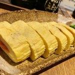 博多野菜巻き串 餃子 きじょうもん - 明太子入り出し巻き玉子¥580(外税)