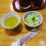 87961420 - お茶、浅漬け、箸