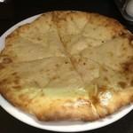 88126658 - チーズナンのアップ。ヘビーです。