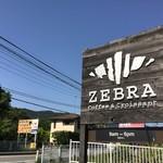 ゼブラ コーヒーアンドクロワッサン - お店の看板