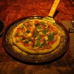 バー レガシー - 料理写真:「本日のおすすめピッツァ」です。