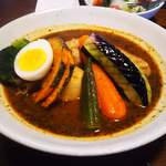 88925435 - 知床鶏野菜のスープカレー チキンと揚げ野菜は定番です