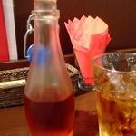 日比谷園 China Cafe&Dining - 夏は瓶に入ったウーロン茶が出されます