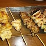 鶏活 - ホルモン入り串盛り(食べかけ…)