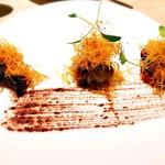 89398746 - 真蛸のコンフィ コリアンダー香るパプリカとタプナード
