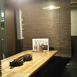 肉×魚×日本酒 照 - 簾で仕切った半個室
