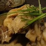 下町割烹とめだて - 栄螺とエリンギの蟹味噌炒め