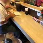 ロメスパ専門店 ボーノボーノ - 店内1階カウンター席