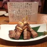 魚真 - マグロの串焼き