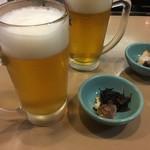 91588334 - 生ビールと付き出しのブリとひじき