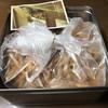 芋舗 芋屋金次郎 - 料理写真:缶を開けたら こんな袋入りやった
