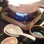彩食健美 くり田 - 特別に用意してもらった辛系鍋です。手前に輪切り唐辛子が・・・