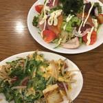 沖縄料理 なんくるないさ - ゴーヤーチャンプルー¥750、海人サラダMサイズ¥680。(いずれも税別)