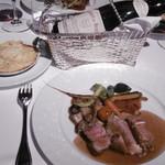 92881210 - お肉料理と赤グラス