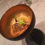 93248588 - アミューズ、魚の名前は忘れましたがバーナーで炙った魚に七面鳥の出汁のソースがかかってます