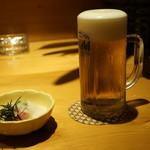 こけし - 生ビールとお通しマグロ山かけ