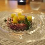 ファニエンテ - 料理写真:牛タンを蒸してコンビーフのように。手間をかけた料理。北あかりを乗せて。