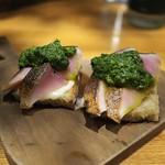 94409308 - あつーく切った脂身たっぷりのしめ鯖のブレスケッタ。イタリアンパセリのソースで。