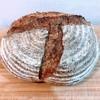 おへそカフェ アンド ベーカリー - 料理写真:世田谷パン祭りにて新麦カンパーニュ 姿がうつくしー。厚めの皮がむぎゅっとした噛み心地でおいしい!