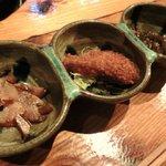 9455136 - 前菜 左から 豚の顔の肉、島豚のカツ、もずく酢。