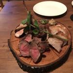 94696081 - ジビエ肉盛り合わせ。                       税抜2990円。                       美味し。