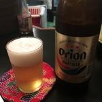 南国洞 - 「オリオンビール」中瓶。560円也。