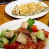 石狩亭 - 料理写真:鎌倉トマトとキュウリとチャーシューの和え物・餃子