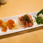 もんなか酒場 串人 - 炙り明太子 580円(横の玉子焼きはサービス)