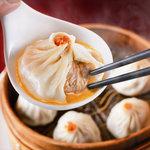 南翔饅頭店 - 料理写真:上海本店の味をそのままに。手作りの看板メニュー小籠包