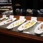 ルモンド・ガーデン - 前菜コーナー。 里芋と生ハムのプチタルト・洋梨とひよこ豆のサラダ・ジャガイモのミルフィーユ・秋鮭のエスカベッシュ・キノコと鶏肉のバルサミコマリネ。