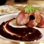 95579014 - ランス産鴨ムネ肉のロースト カシスソースを添えて