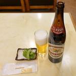 東都グリル - キリン大瓶650円とサービスの枝豆