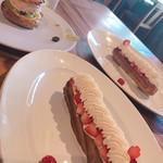 97339576 - パリ ブレスト シャインマスカット                       赤い実とホワイトチョコレートのエクレール