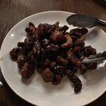 97450525 - 豚肉とカシューナッツの黒酢仕立て