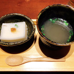 97598430 - お通し 鶏スープと山芋豆腐