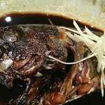 97918679 - 北海道産クロソイ煮つけ。