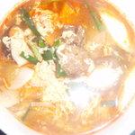 花暖 - じっくり煮込んだ美味しいカルビ肉が入った少し辛口の雑炊です。お酒の後にも是非どうぞ!