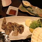 居酒屋くろちゃん - 唐揚げ(食べかけ)