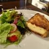サンジャック - 料理写真:タルトオニオンにサラダを+100円で追加♪